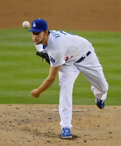 Los Angeles Dodgers starting pitcher Clayton Kershaw throws to the plate during the first inning of their baseball game against the Colorado Rockies, Friday, July 12, 2013, in Los Angeles. (AP Photo/Mark J. Terrill)