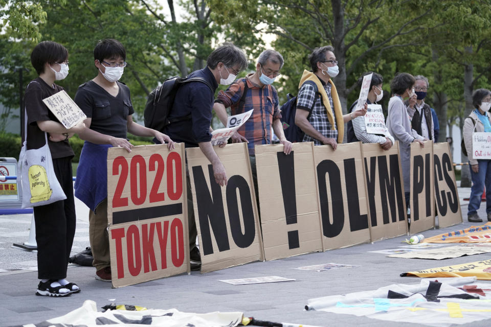 People against the Tokyo 2020 Olympics set to open in July, protest around Tokyo's National Stadium during an anti-Olympics demonstration Sunday, May 9, 2021. (AP Photo/Eugene Hoshiko)