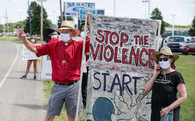 Protesters against the death penalty gather in Terre Haute, Indiana - AP