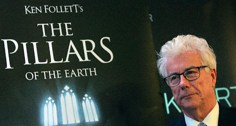 "Ken Follett alongside an advertisement for his ""The Pillars of the Earth"" bestseller -- one of whose scenes is set in a Parisian cathedral that readers may very well assume is Notre-Dame"