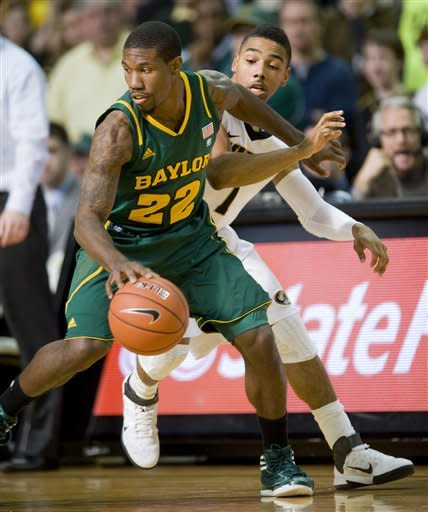 Missouri's Phil Pressey, right, tries to steal the ball from Baylor's A.J. Walton, left, during the second half of an NCAA college basketball game, Saturday, Feb. 11, 2012, in Columbia, Mo. Missouri won the game 72-57. (AP Photo/L.G. Patterson)