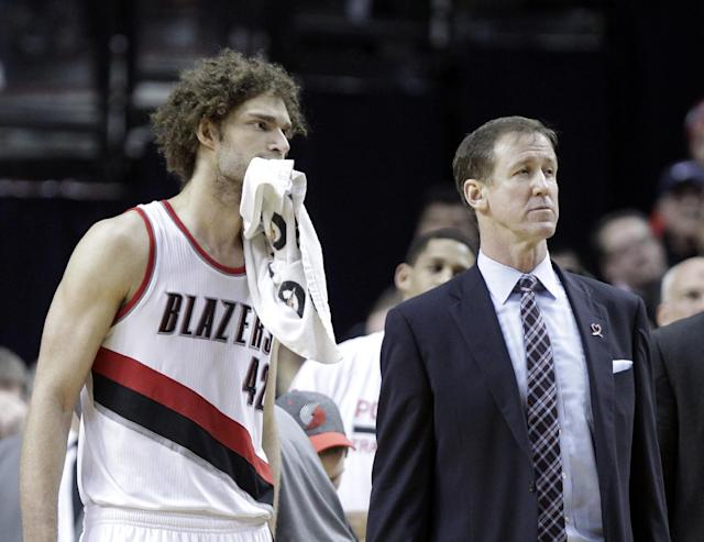 Portland Trail Blazers center Robin Lopez, left, and coach Terry Stotts watch as they lose the review on an out-of-bounds call late in the second half of an NBA basketball game against the Oklahoma City Thunder in Portland, Ore., Tuesday, Feb. 11, 2014. The Thunder won 98-95. (AP Photo/Don Ryan)
