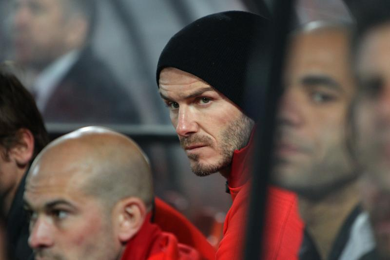 English midfielder David Beckham of Paris Saint Germain watches from the bench during his French League One soccer match against Lorient, Sunday, May 26, 2013 in Lorient, western France. Beckham play officially his last game tonight as a professional player. (AP Photo/David Vincent)