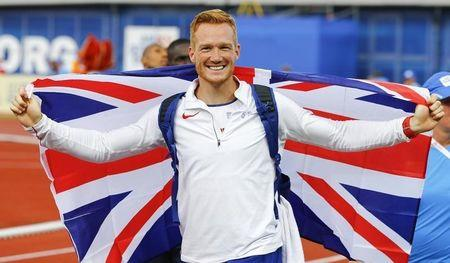 Athletics - European championships - Men's long jump final - Amsterdam - 7/7/16 Britain's Greg Rutherford celebrates REUTERS/Michael Kooren