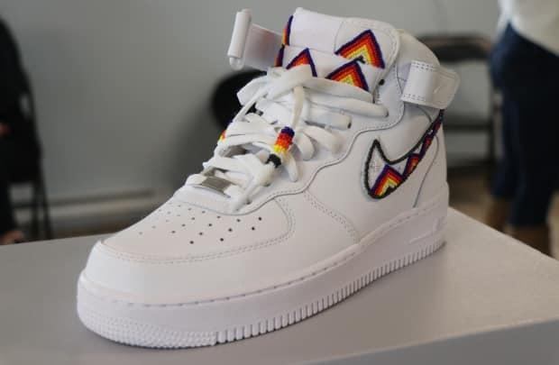 A beaded Air Force One high-top sneaker made by Mi'kmaw artist Cheyenne Isaac-Gloade. Isaac-Gloade and her husband put on a sneaker workshop for youth in Millbrook First Nation on Saturday. (Jeorge Sadi/CBC - image credit)