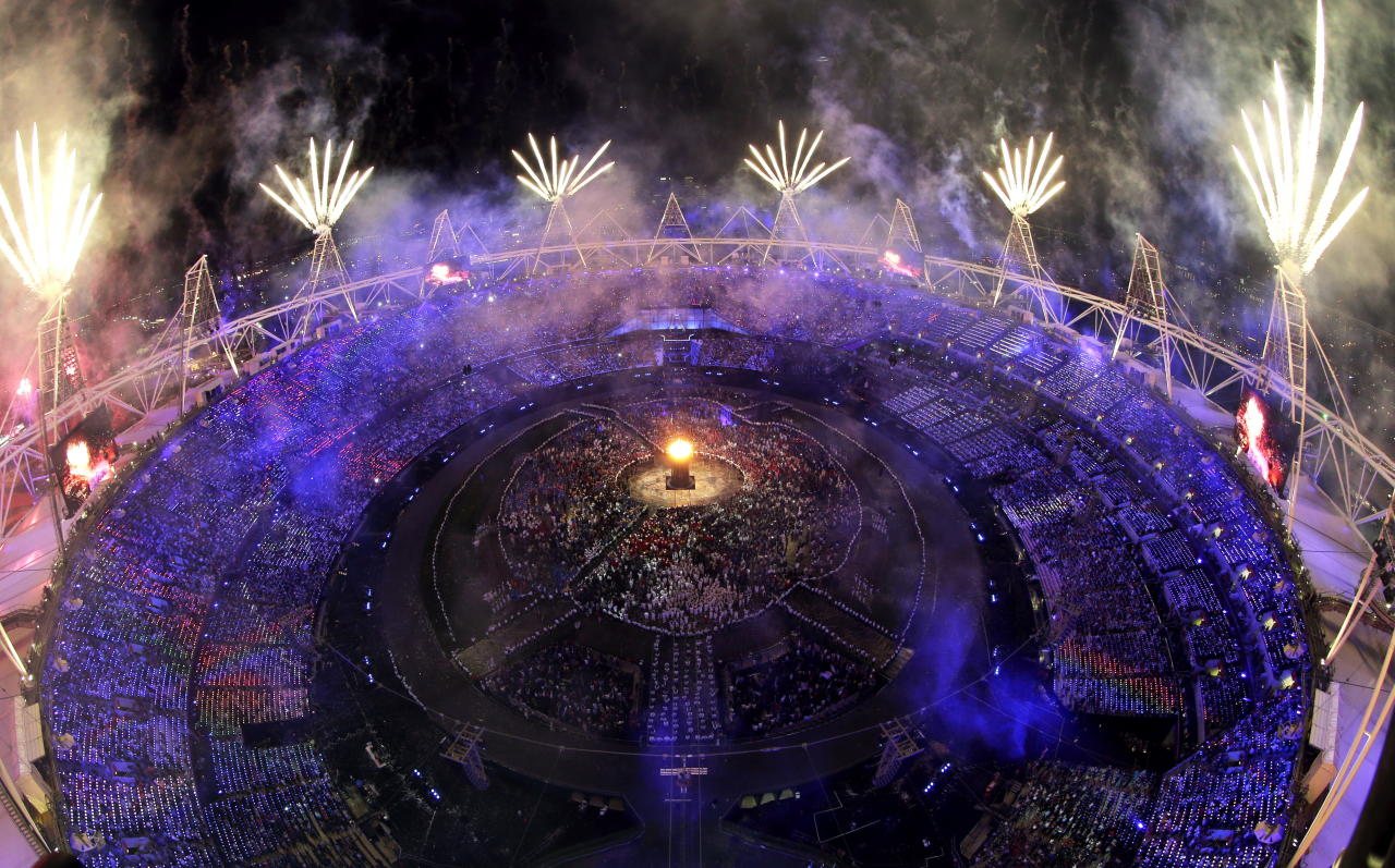 Fireworks light up over the stadium during the Opening Ceremony at the 2012 Summer Olympics, Saturday, July 28, 2012, in London. (AP Photo/David J. Phillip)