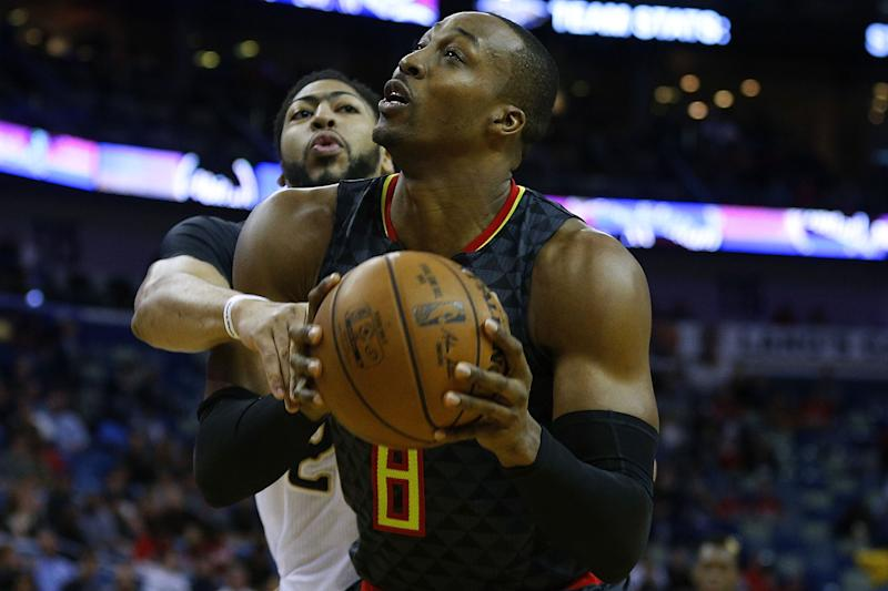 Anthony Davis would reportedly prefer Dwight Howard bear the brunt of banging with Western Conference centers. (Getty)
