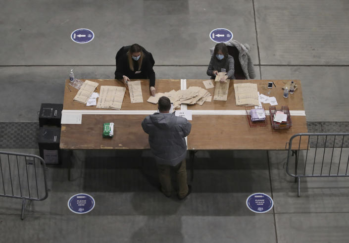 Ballots are counted for the Scottish Parliamentary Elections in Aberdeen, Scotland, Friday May 7, 2021. (Andrew Milligan/PA via AP)