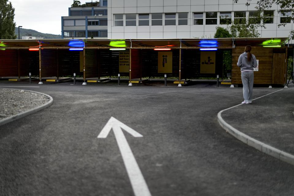 """A prostitute faces """"sex boxes"""" in Zurich on the opening day of Switzerland's first sex drive-in, Aug. 26, 2013. (Photo: Fabrice Coffrini/AFP/Getty Images)"""