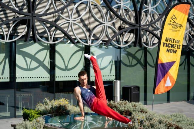 Max Whitlock poses in front of the Library of Birmingham