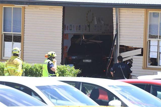 The Toyota Kluger crashed through the wall of the school on Tuesday morning. Source: AAP