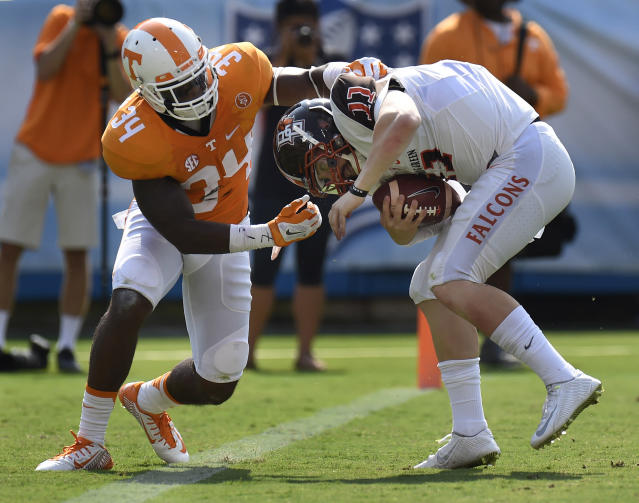 Tennessee linebacker Darrin Kirkland (34) sacks Bowling Green quarterback Matt Johnson (11) for a 9-yard loss in the first half of an NCAA college football game Saturday, Sept. 5, 2015, in Nashville, Tenn. (AP Photo/Mark Zaleski)