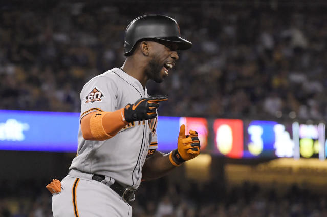 San Francisco Giants' Andrew McCutchen celebrates after hitting a three-run home run during the eighth inning of the team's baseball game against the Los Angeles Dodgers on Wednesday, Aug. 15, 2018, in Los Angeles. (AP Photo/Mark J. Terrill)