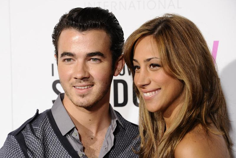 """FILE - In this Sept. 12, 2011 file photo, singer Kevin Jonas and his wife Danielle Deleasa attend the Cinema Society premiere of """"I Don't Know How She Does It"""", in New York.  The E! Entertainment network has expansion plans that include a new music series from """"American Idol"""" producer Nigel Lythgoe, a reality series with Kevin Jonas, the oldest member of the Jonas Brothers and his new bride and a talk show starring Whitney Cummings. (AP Photo/Peter Kramer, file)"""