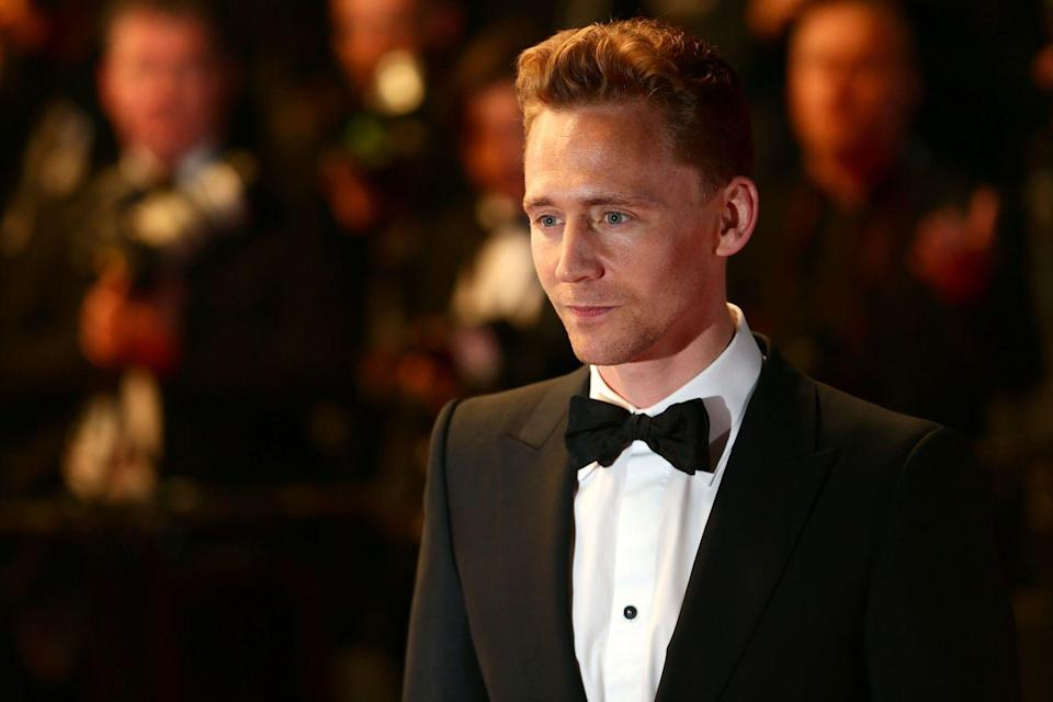"""<p>Look—Loki isn't quite James Bond-esque. We get that. But did this man not look perfectly, impossibly suave in that <a href=""""https://www.menshealth.com/entertainment/a36673657/loki-db-cooper-hijacker-true-story/"""" rel=""""nofollow noopener"""" target=""""_blank"""" data-ylk=""""slk:D.B. Cooper"""" class=""""link rapid-noclick-resp"""">D.B. Cooper</a> sequence in Loki's first episode? He also proved his super spy bonafides in The Night Manager, his non-MCU action bonafides in Kong: Skull Island, and turned the charm up to a million as another iconic man in a suit, F. Scott Fitzgerald, in Midnight in Paris. Hiddleston would be a more-than-worthy pick. —ER</p>"""