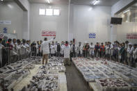 Fish is displayed for merchants during an auction at the main port in Dakhla city, Western Sahara, Monday, Dec. 21, 2020. U.S. plans to open a consulate in Western Sahara mark a turning point for the disputed and closely policed territory. U.S. recognition of Morocco's authority over the land frustrates indigenous Sahrawis seeking independence. But others see the future U.S. consulate as a major boost for Western Sahara cities like Dakhla. (AP Photo/Mosa'ab Elshamy)