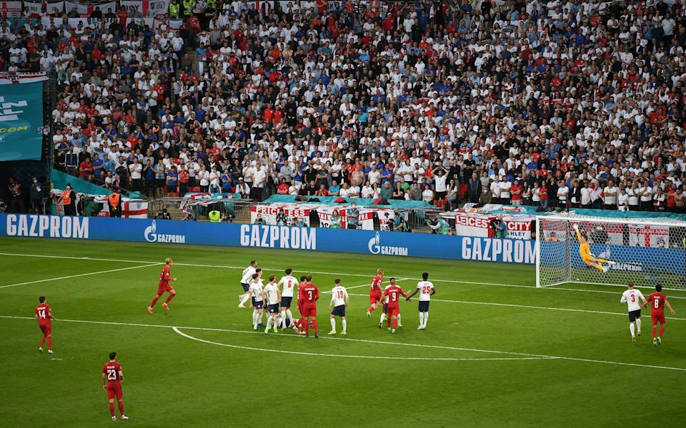 Mikkel Damsgaard of Denmark scores their side's first goal past Jordan Pickford of England during the UEFA Euro 2020 Championship Semi-final match between England and Denmark at Wembley - Why Denmark's free-kick goal was just as dodgy as England's penalty - GETTY IMAGES