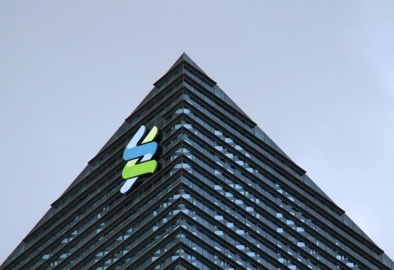 The logo of Standard Chartered is seen at its new Singapore office at the Marina Bay Financial Centre