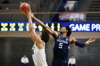 Connecticut's Isaiah Whaley, right, and Villanova's Jeremiah Robinson-Earl leap for a rebound during the second half of an NCAA college basketball game, Saturday, Feb. 20, 2021, in Villanova, Pa. (AP Photo/Matt Slocum)
