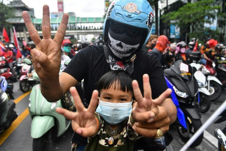 Protesters flashed the three-finger salute of resistance