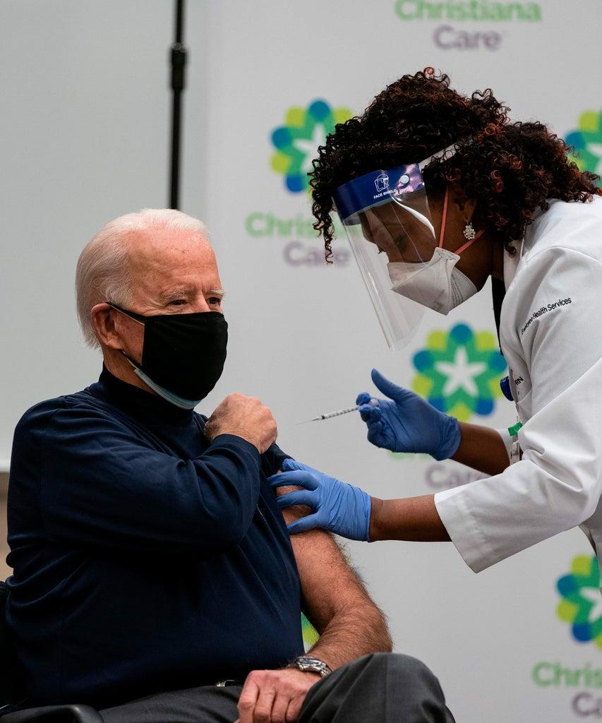 US President-elect Joe Biden receives a Covid-19 vaccination from Tabe Mase, Nurse Practitioner and Head of Employee Health Services, at the Christiana Care campus in Newark, Delaware on December 21, 2020. (Photo by ALEX EDELMAN / AFP) / The erroneous mention[s] appearing in the metadata of this photo by ALEX EDELMAN has been modified in AFP systems in the following manner: [Tabe Mase] instead of [Tabe Mase]. Please immediately remove the erroneous mention[s] from all your online services and delete it (them) from your servers. If you have been authorized by AFP to distribute it (them) to third parties, please ensure that the same actions are carried out by them. Failure to promptly comply with these instructions will entail liability on your part for any continued or post notification usage. Therefore we thank you very much for all your attention and prompt action. We are sorry for the inconvenience this notification may cause and remain at your disposal for any further information you may require. (Photo by ALEX EDELMAN/AFP via Getty Images)