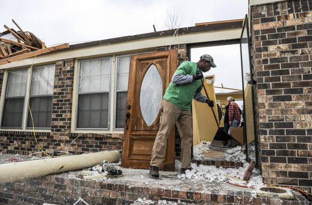 <p>Phillip Moore helps cleanup a house that was destroyed Tuesday, March 20, 2018, in Ardmore, Ala., after a violent storm went swept through the area the night before. (Photo: Jeronimo Nisa/The Decatur Daily via AP) </p>