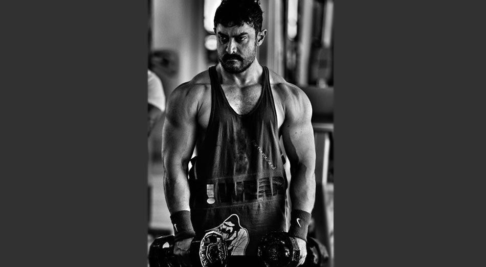 <p>Perfectionist Aamir Khan is all beefed up for his role as a wrestler in his upcoming flick <i>Dangal</i> The actor recently posted a picture of his sculpted body on Twitter and boy does he look terrific<i>.</i> However, this is not the first time Aamir is working on his physique. The actor created uproar with his sexy six-pack in <i>Ghajini</i>, for which he went on a high fibre and low carb diet. Well, this is definitely not surprising from a perfectionist like Aamir!</p>