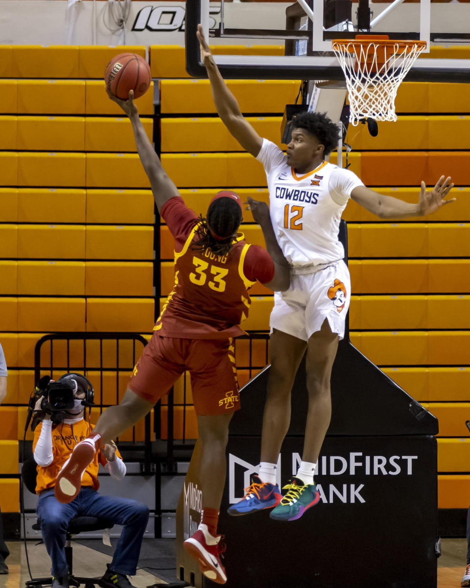 Oklahoma State forward Matthew-Alexander Moncrieffe (12) guards Iowa State forward Solomon Young (33) during the second half of the NCAA college basketball game in Stillwater, Okla., Tuesday, Feb. 16, 2021. (AP Photo/Mitch Alcala)
