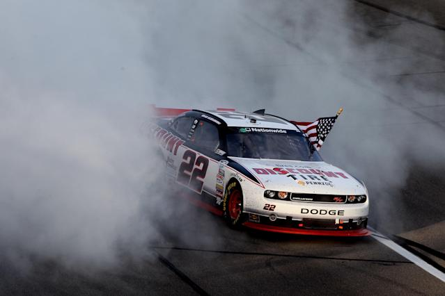 KANSAS CITY, KS - OCTOBER 08: Brad Keselowski, driver of the #22 Discount Tire Dodge, celebrates with a burnout after winning the NASCAR Nationwide Series Kansas Lottery 300 at Kansas Speedway on October 8, 2011 in Kansas City, Kansas. (Photo by Jamie Squire/Getty Images)