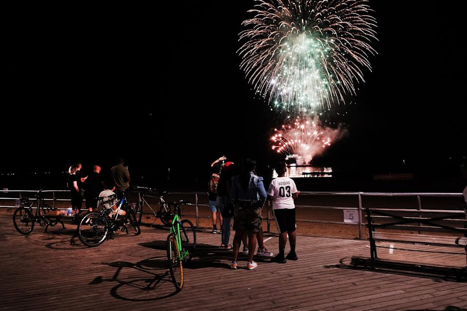 A sparse crowd watches a fireworks show at Coney Island as part of the annual Macy's 4th on June 29, 2020 in New York City.