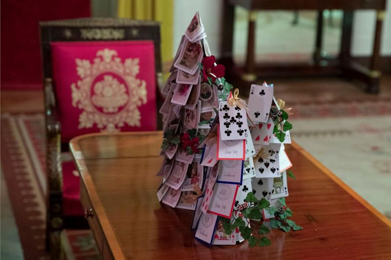 The Red Room is decorated with games, including a tree made of White House playing cards during the 2019 Christmas preview at the White House, Monday, Dec. 2, 2019, in Washington.