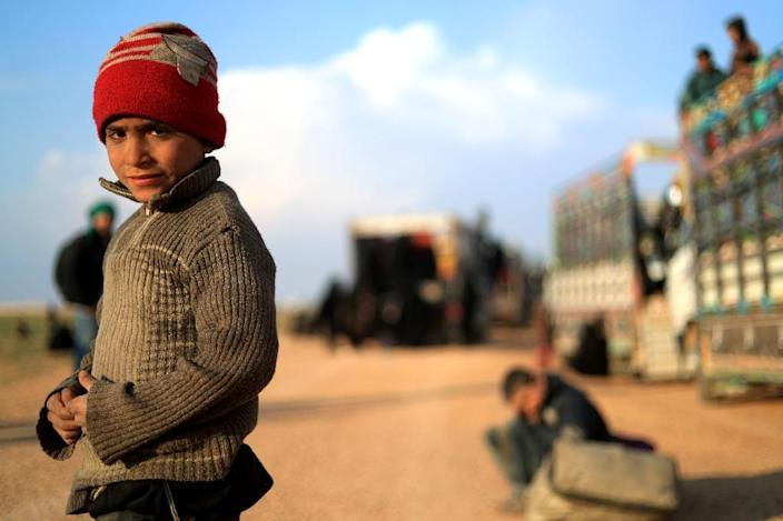 Civilians fleeing the last Islamic State group enclave in Syria are trucked north to Kurdish-run camps for the displaced (AFP Photo/Delil SOULEIMAN)