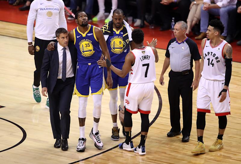 Kyle Lowry of the Toronto Raptors reacts as Kevin Durant #35 of the Golden State Warriors is carried off the court in the first half during Game Five of the 2019 NBA Finals at Scotiabank Arena on June 10, 2019 in Toronto, Canada. NOTE TO USER: User expressly acknowledges and agrees that, by downloading and or using this photograph, User is consenting to the terms and conditions of the Getty Images License Agreement.