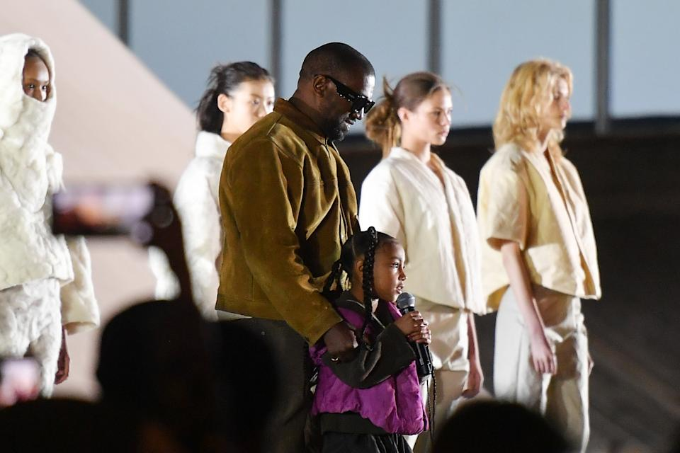 Kanye West and daughter North at a fashion event