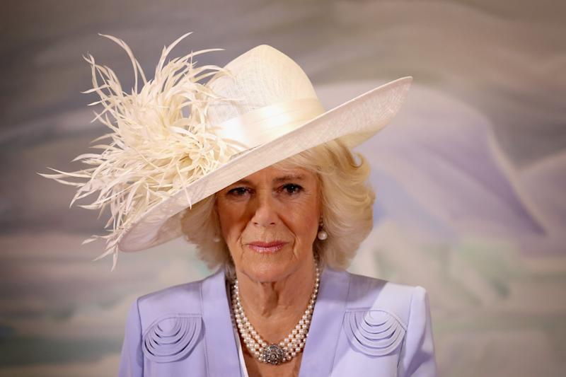Camilla Duchess of Cornwall in feathered hat and lilac suit