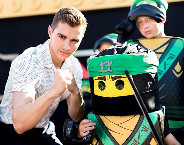 <p>Franco looked particularly fierce opposite one of the characters from the upcoming <em>LEGO Ninjago Movie</em>, to which he lends his voice, at Legoland. (Photo: Greg Doherty/Getty Images) </p>