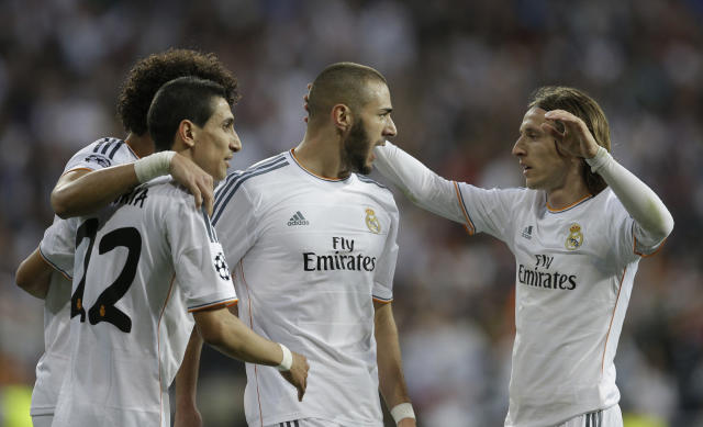 Real's Karim Benzema, center, celebrates scoring the opening goal during a Champions League semifinal first leg soccer match between Real Madrid and Bayern Munich at the Santiago Bernabeu stadium in Madrid, Spain, Wednesday, April 23, 2014 .(AP Photo/Paul White)