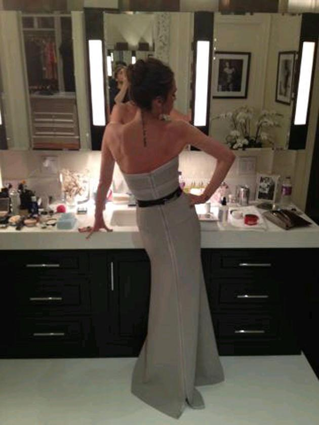 Celebrity photos: Victoria Beckham tweeted this picture on the night of the Oscars as she got ready for the Vanity Fair after-party. We love the fact that there's a framed photo of David Beckham in his pants on the wall as well!