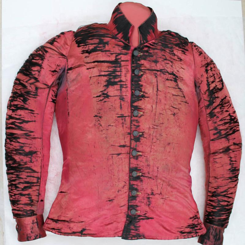 First Grand National winner Jem Mason's silk jacket, after restoration - National Heritage Centre for Horseracing