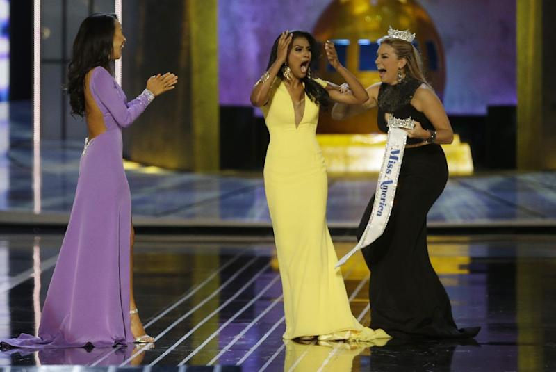 Miss New York Nina Davuluri, center, reacts after being named Miss America 2014 pageant as Miss California Crystal Lee, left, and Miss America 2013 Mallory Hagan celebrate with her, Sunday, Sept. 15, 2013, in Atlantic City, N.J. (AP Photo/Mel Evans)