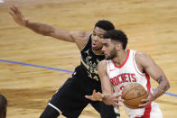 Houston Rockets' Anthony Lamb drives to the basket against Milwaukee Bucks' Giannis Antetokounmpo (34) during the first half of an NBA basketball game Friday, May 7, 2021, in Milwaukee. (AP Photo/Aaron Gash)