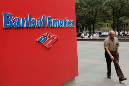 A man walks past a Bank of America sign in New York