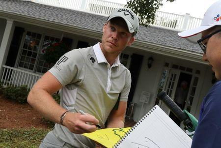 Willett of England signs an autograph during practice rounds for the 2017 Masters at Augusta National Golf Course in Augusta