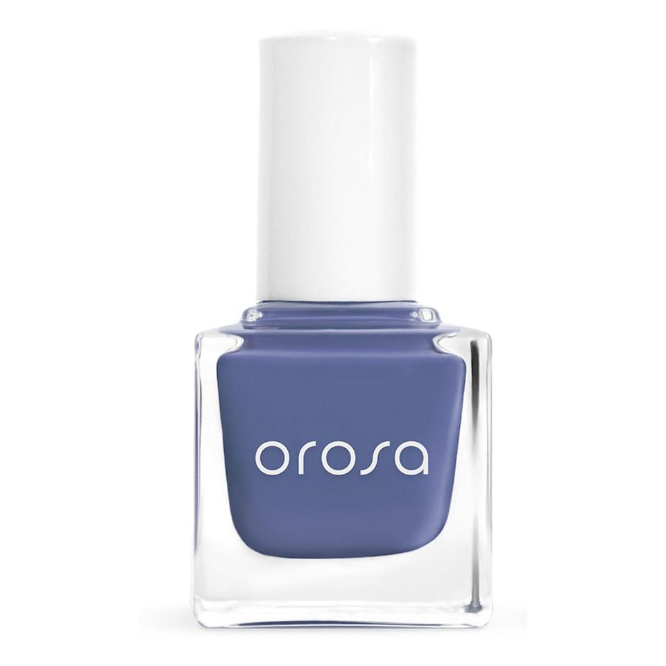 """<p>Orosa's Nail Polish in Twilight has an almost smoky effect that keeps the blue more muted and neutral for every day. Added bonus: The super-clean, vegan formula has a 14-ingredient long """"nope"""" list and the cuticle-hugging rounded brush makes that at home manicure easier than ever.</p> <p><strong>$12</strong> (<a href=""""https://orosabeauty.com/products/twilight"""" rel=""""nofollow noopener"""" target=""""_blank"""" data-ylk=""""slk:Shop Now"""" class=""""link rapid-noclick-resp"""">Shop Now</a>)</p>"""