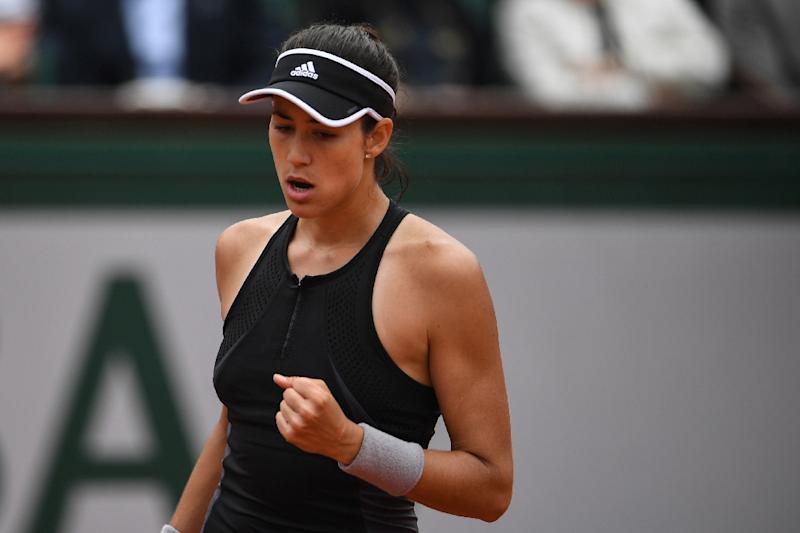Halep too hot to handle for Muguruza in Paris