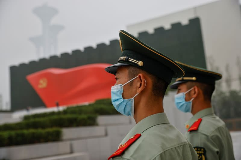 Officers of the People's Armed Police stand guard outside the Museum of the Communist Party of China that was opened ahead of the 100th founding anniversary of Party in Beijing