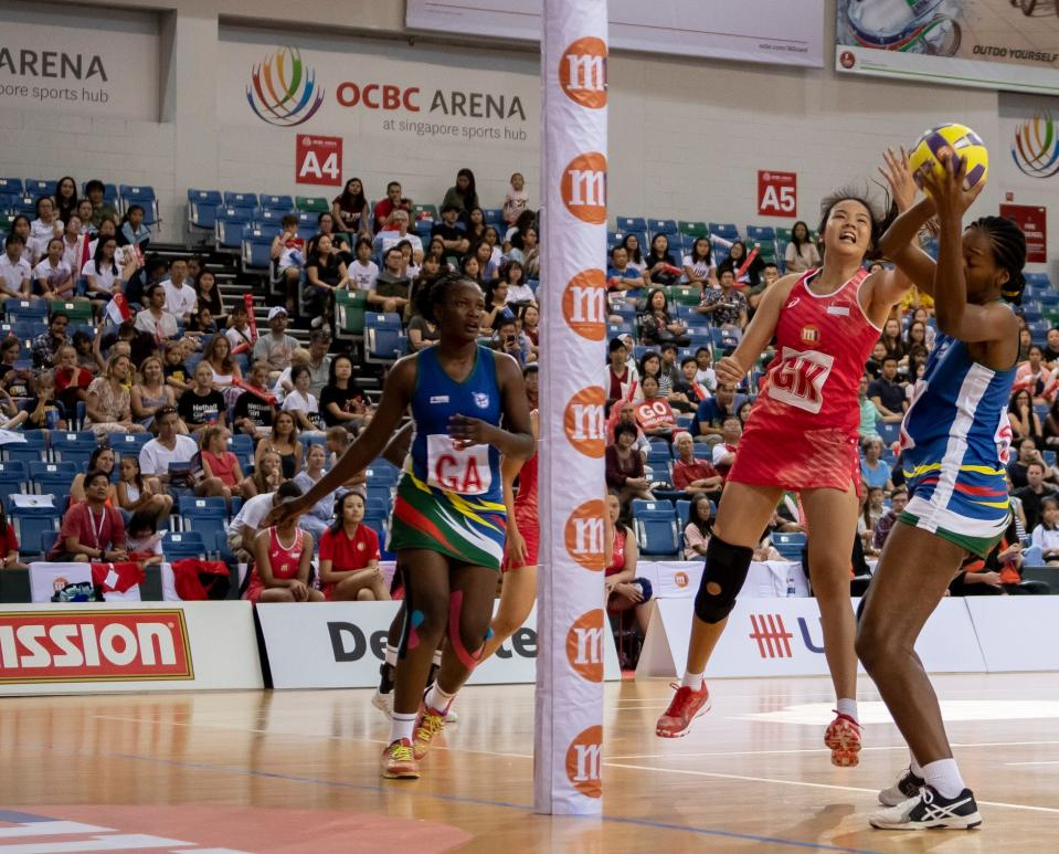 Singapore (red jersey) and Namibia netballers in action at the M1 Netball Nations Cup at OCBC Arena. (PHOTO: Netball Singapore)