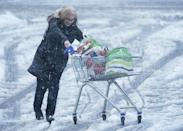 A woman pushes a shopping trolley through snow in Hexham, Northumberland. Heavy snow and freezing rain is set to batter the UK this week, with warnings issued over potential power cuts and travel delays. (Photo by Owen Humphreys/PA Images via Getty Images)