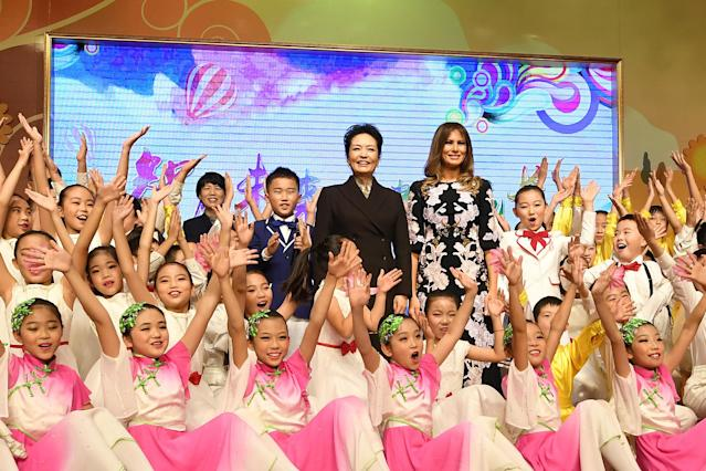 First lady Melania Trump and China's first lady, Peng Liyuan, are surrounded by students after a cultural performance during a visit to Banchang Primary School in Beijing on Nov. 9. (Photo: Reuters/Greg Baker/Pool)