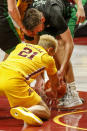 North Dakota forward Filip Rebraca (12) battles with Minnesota forward Jarvis Omersa (21) for the ball in the first half of an NCAA college basketball game Friday, Dec. 4, 2020, in Minneapolis. (AP Photo/Bruce Kluckhohn)